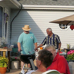 Bob and Ron handle the cooking duties.